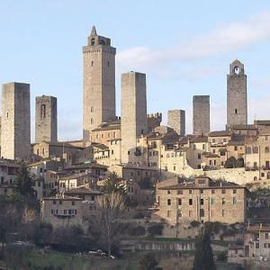 Nicknamed the medieval Manhatten, San Gimignano is a village in Tuscany famous for its 14 stone towers. At the height of San Gimignano's wealth and power, more than 70 towers were built to defend the town against enemy attacks. After the plague devastated the city in 1348, San Gimignano's power faded, which kept enemies away and preserved many of the city's medieval towers.