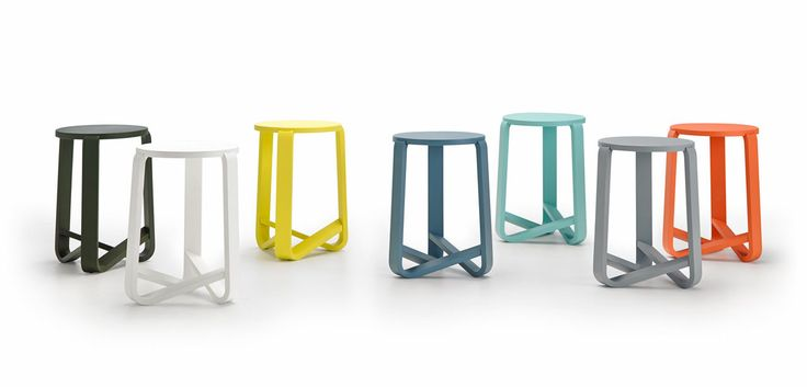 A molded wooden stool with three legs, each shaped like a J, with one leg connecting to another leg and at the seat, creating a sculptural base.