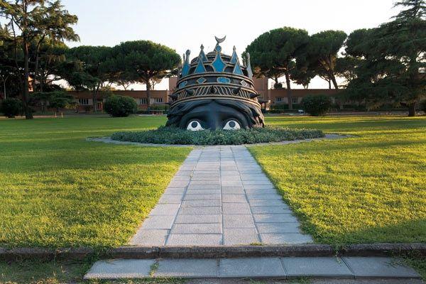 """Entrance to Cinecittà, Rome, Italy   (Big head by Danilo Donati for Fellini Movie """"Casanova"""")"""