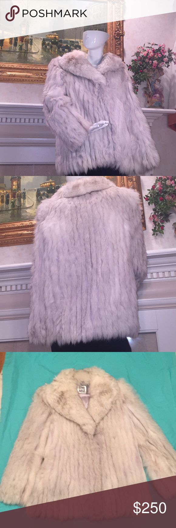 "Vintage SAGA silver fox fur coat EUC Just in time for winter this fox fur coat is stylish without being ostentatious. Soft and warm with two pockets it closes with ""snap hooks"" typical of fur coats. The collar is exceptionally soft.  Purchased in Seattle and only worn for special occasions. Tag says large see pics for measurements Saga Furs Jackets & Coats"
