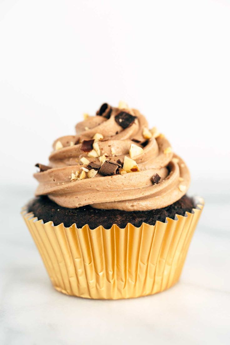 Ferrero Rocher inspired cupcakes recipe with chocolate ganache filling and Nutella hazelnut buttercream