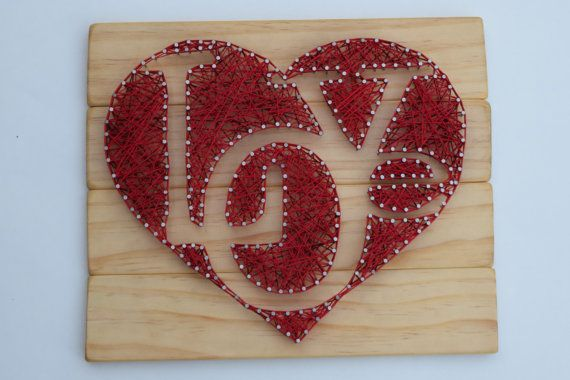 Handcrafted LOVE Heart string art. Natural wood stain with red embroidery thread. This piece measures approximately 12 x 10 inches. Ships