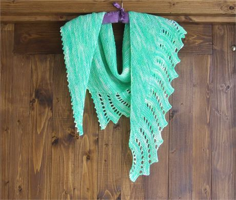 Ladies Hand knitted shawl / scarf Asymmetrical shape - very lightweight Knitted in a fine garter stitch - wingspan shawl Can be worn in a variety of styles - versatile item Great as a Spring cover up    One of a kind item knitted in beautiful shades of green fine merino yarn - This yarn is hand dyed by an independent yarn dyer in a unique colourway.   Comes with storage pouch   Material - 75% Merino wool 25% Nylon- cold wash only    Size - Length 16 (40 cm) x 60 (152 cm) wingspan   Colou...