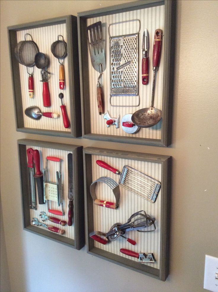 Vintage kitchen utensils displayed in a shadow box. I took the glass out of the shadow box frame and lined the back board with fabric. I used aluminum wire to affix the utensils to the board.