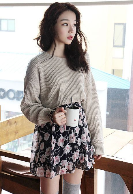 Floral skirt, over the knee socks, and knit sweater but I'd prefer it to be less baggy:
