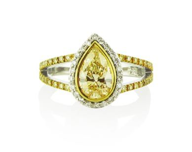 An 18ct White and Yellow Gold, Fancy Yellow Pear Shaped Diamond Halo Ring with a Split Band