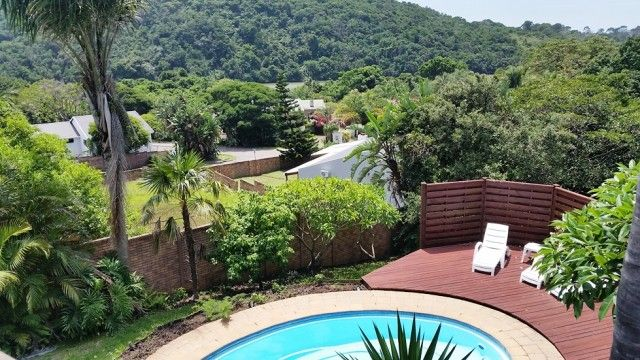 Set in the tranquil Gonubie River Valley, this double story home comes complete with pool, sundeck, 2 garages, 3 bathrooms and 4 bedrooms! All surrounded by active plant and bird life!