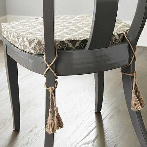This comfy cushion is designed exclusively to fit our Grecian-inspired Arletta Klismos Dining Chair. Made of soft cotton blend with generous jute tassel corner ties that flow down the back legs for an elegant finishing touch.Arletta Klismos Dining Chair Cushion features:Contoured for a perfect fitMade in the USA