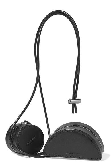 Black leather  Zip fastening along top and sides Comes with dust bag Weighs approximately 0.7lbs/ 0.3k As seen in The EDIT magazine