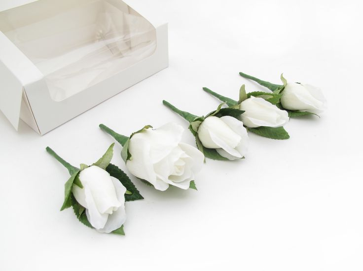 Buttonholes by https://www.loveflowers.com.au These show the difference in size between the large rosebud and the regular rosebud in the Fresh Touch Roses range.