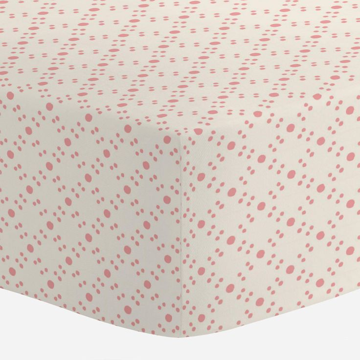 "Crib Fitted Sheet in Coral Pink Tropic Floral by Carousel Designs.  Our fitted crib sheets feature deep pockets and have elastic all the way around the edges to hug mattresses securely. Fits standard crib mattresses, measuring approximately 28"" x 52""."