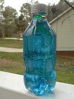 Space sensory bottles  •Mini (12 oz) soda bottles  •Faceted colored beads of various sizes  •Silver glitter  •Blue food coloring (optional)  •Corn syrup (this is what gives it the floating effect)