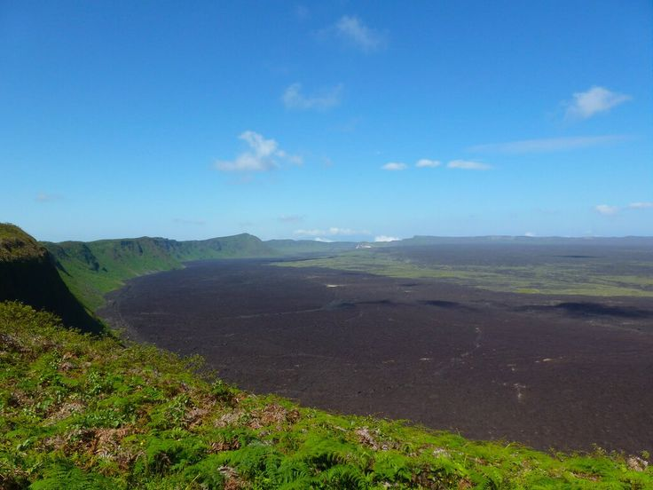 Sierra Negra Volcano Crater on Isabela Island. A popular day trip from Puerto Villamil is a guided hike to the crater