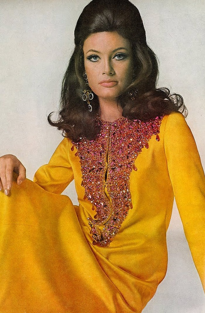 Actress Marisa Mell is wearing a chrome-yellow satin twill dress with a jewelled bib by Oscar De La Renta, photo by Bert Stern for Vogue, 1967