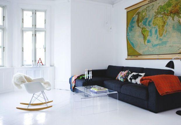 White living room. Love the giant vintage world map.