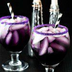 Purple People Eater Cocktail! A tasty (and creepy!) purple people eater drink that get's it's purple hue from blue curacao, grenadine, and cranberry juice. | HomemadeHooplah.com