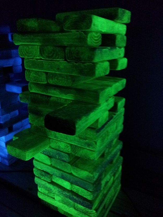Paint games like Jenga with glow-in-the-dark paint. | 27 Incredibly Easy Ways To Upgrade Any Halloween Party