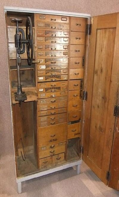 I frequently get art room storage envy.  This unit sets that envy raging.  It would probably store most of my bits and pieces.  The drill does not bother me.  I like the reminder of its roots and I would enjoy thinking of the people who used the unit.  Why remove part of the charm?