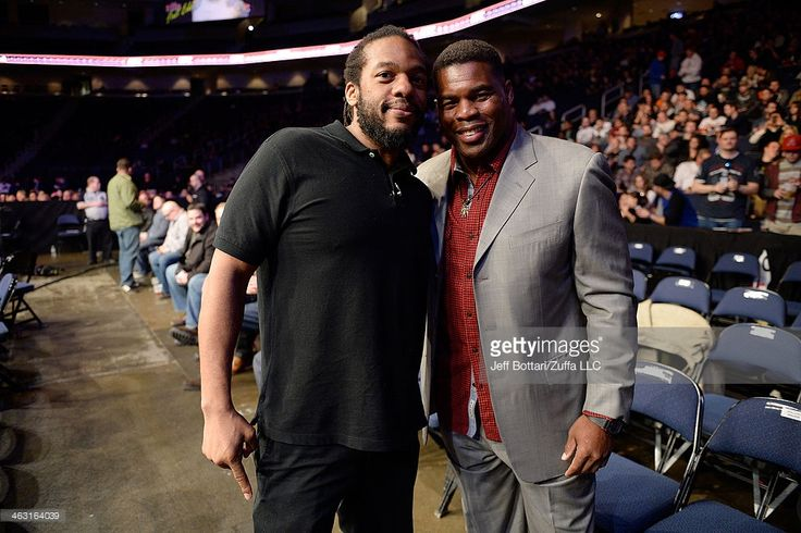 Referee Herb Dean and former NFL player Herschel Walker pose before the lightweight fight between Justin Edwards and Ramsey Nijem during the UFC Fight Night event inside The Arena at Gwinnett Center on January 15, 2014 in Duluth, Georgia.