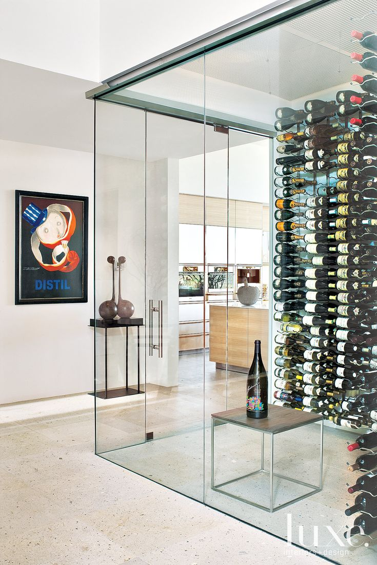 Okay. So maybe this modern glass wine cellar is going a bit far... Maybe we could live with just a big wine fridge in the dream house... But I still like it! :)