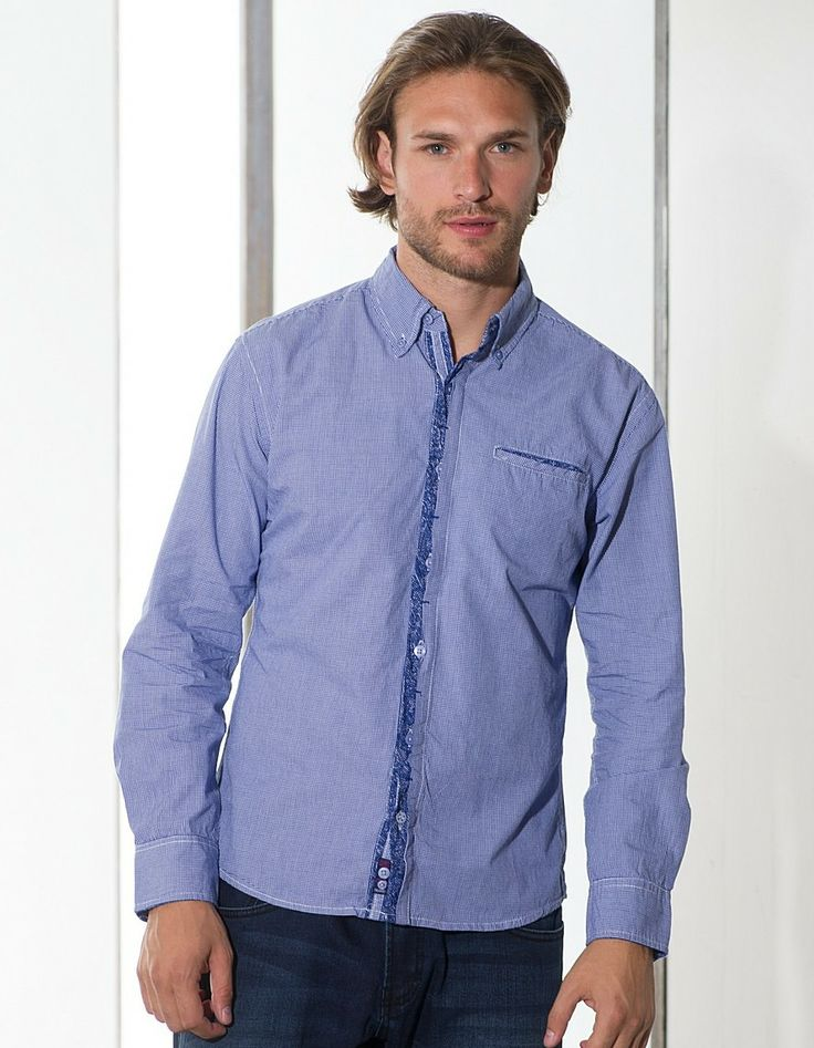 M265395.  Classic blue gingham checks combined with our bespoke button placket make this shirt which can be worn in office, club or on a date. Lots of small details add on to the elegance of this masterpiece.  Kindly pay attention to the trim fabric and inner placket, its sure to raise some eyebrows.