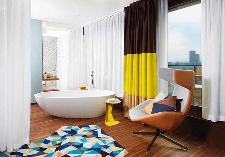 Yellow mellow at 25Hours hotel Zürich, featuring Spoon XL bathtub by Agape. Architect Alfredo Häberli. Ph. Stephen Lemke. #lounge #weekend #interiordesign #color #yellow #bath #texture #mix #roomwithaview #summer #zurich #25hourshotel