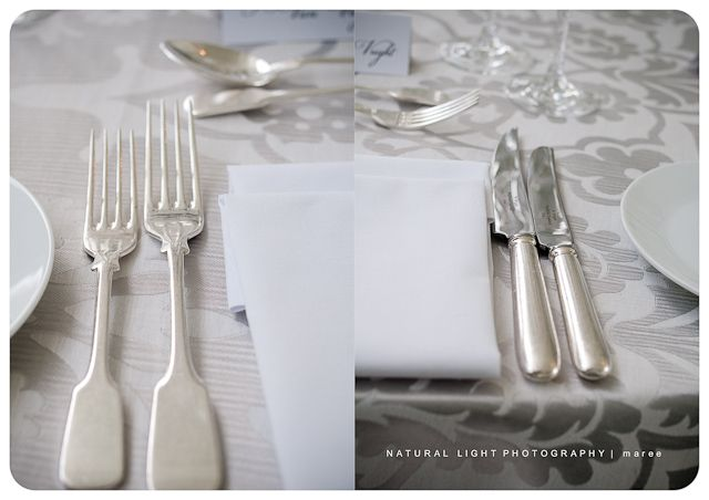 Patterned table cloth and beautiful flatware.
