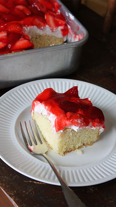"Put an easy twist on a summery classic with this sheet-cake shortcut accented with whipped cream cheese topping and juicy strawberries. And, best of all, only 15 minutes of prep time and four steps! Says Betty member Twells36, ""I have a family of 10 and it was a huge hit!!"""