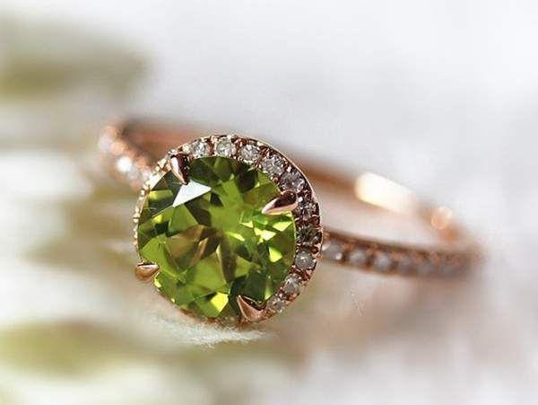 Colored gemstones are the hottest engagement ring trend and it's easy to see why. This handmade round peridot engagement ring is definitely one of our favorites. ($479)