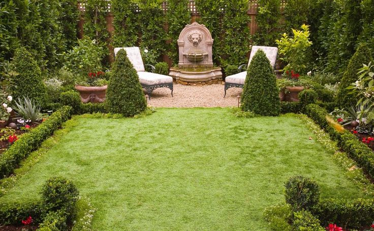 Traditional Landscape/Yard with Raised beds, Pond, Green Velvet Boxwood, Fence, exterior stone floors, Bird bath, Fountain