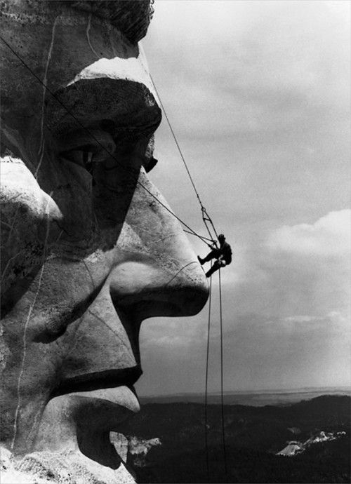 Repairman on Face of Abraham Lincoln from Mount Rushmore Memorial by Gutzon Borglum, June 9, 1962