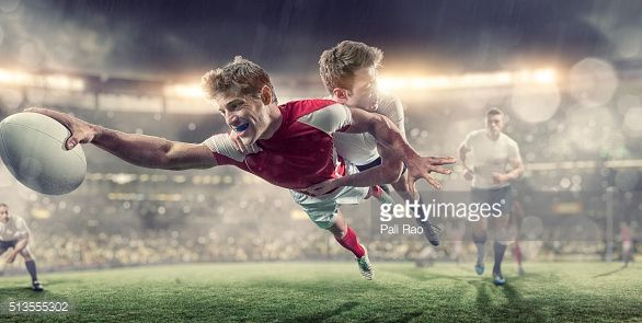 Stock Photo : Rugby Player Diving To Score During Tackle in Rugby Game