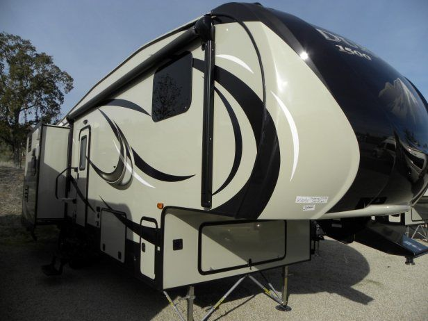 All the features you would find in a full profile luxury fifth wheel wrapped up in a light weight half ton towable coach. Island kitchen and free standing dining table with 4 chairs. 50 Amp service with both cable and satellite hookups. Framed and pre-wired for 2nd air conditioner.Fold down cargo and bike rack. Strong Arm front landing gear stabilizing system. Ground Control 3.0 automatic leveling system. Only 1 in stock. Hurry in today to see more of this beautiful fifth wheel.