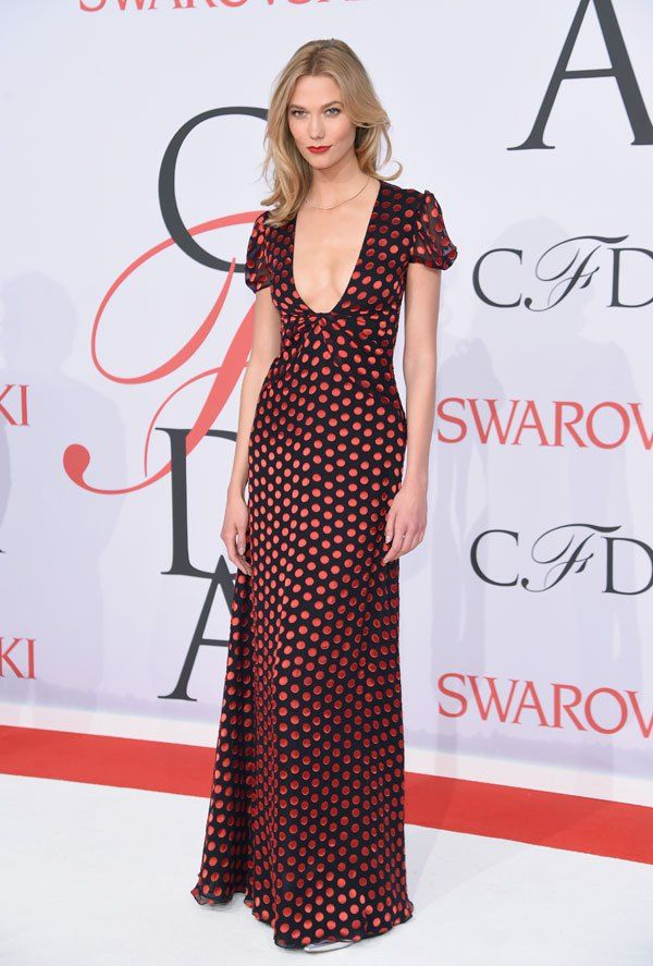 Karlie Kloss takes the plunge in a red and black polka dot down at the 2015 CFDA awards in NYC