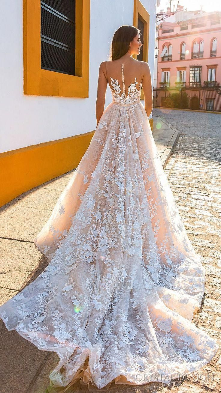 Best wedding dresses for travel  Crystal Design   Bridal gown with deep plunging sweetheart