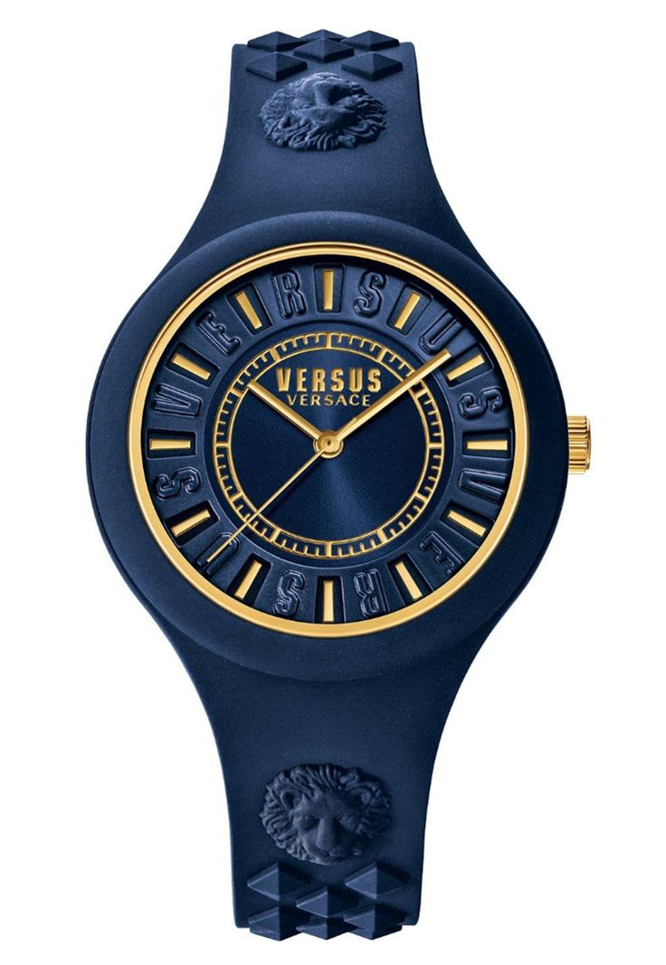 Versus Versace Fire Island Watch in navy blue.  Versus Versace's classic Fire Island Watch is made with a Japanese Quartz movement that is held within a navy blue rubber case and strap with moulded studs and lion head detail.  The blue dial is edged with 'Versus' branding with gold lines to mark the hours as well as Versus Versace branding.