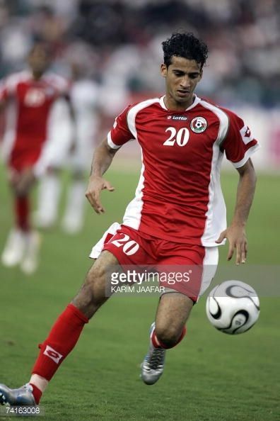 Omani football team player Imad alHosni runs for the ball during the 18th Gulf Cup championship football match against UAE in the Emirati capital of...