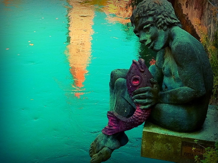 Statue on a building next to the river in Sacile Italy...cant wait to move there.