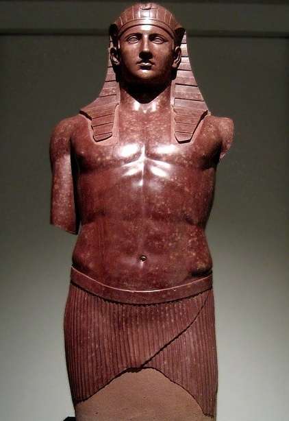 Antinous as pharaoh, red marble, 2th century CE -- Lover of emperor Hadrian, Antinous died by drowning. Hadrian decreed his deification, so cities were founded in his name, medals struck with his effigy, and statues erected to him in all parts of the empire.