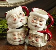 Santa mugs...we had these when we were kids. Luv the winking blinking different faces