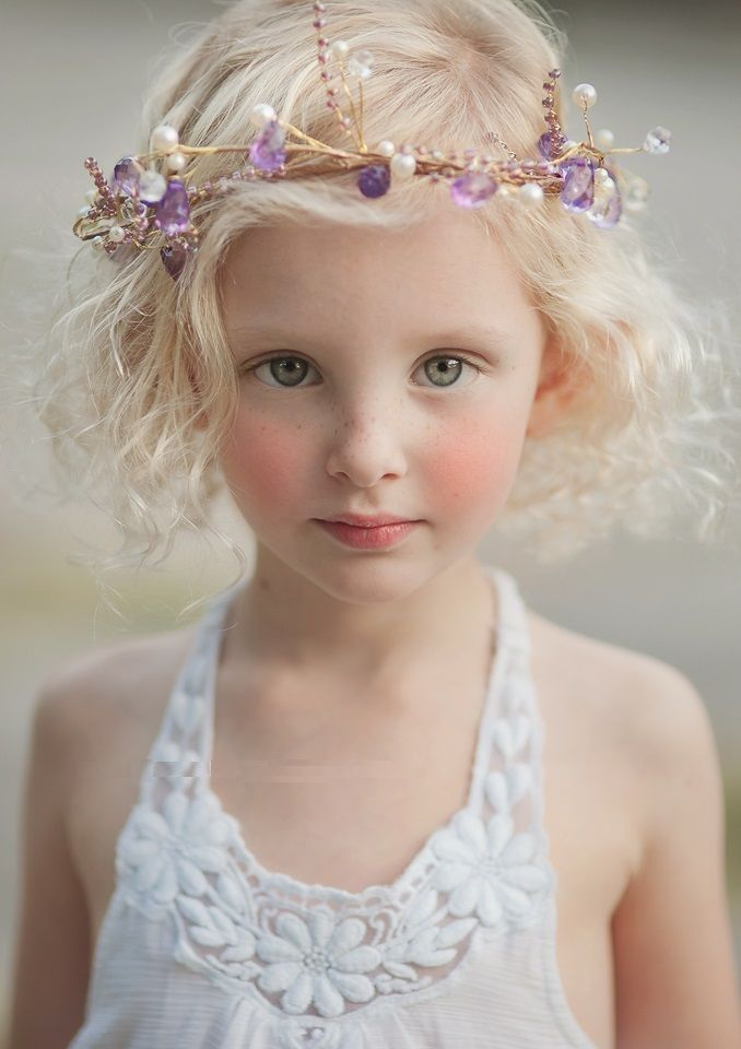 Flower crown! Beautiful portrait pose for a little girl. She looks angelic. Brooke Logue Photography