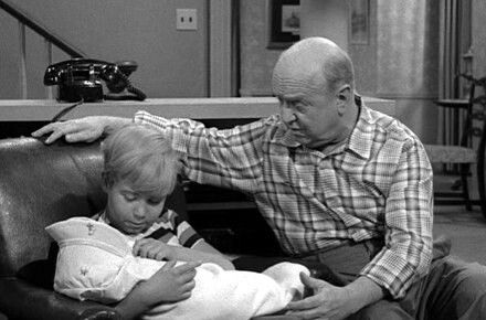 Chip (Stanley Livingston) holds a Baby while Bub (William Frawley) looks on.