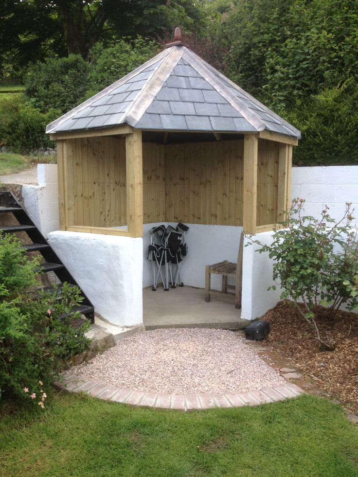 Slate Roofed Arbour From The Wooden Workshop, Crafted To Fit An Existing Walled Area. Call 01398 332266 For More Information Or To Place An Order.