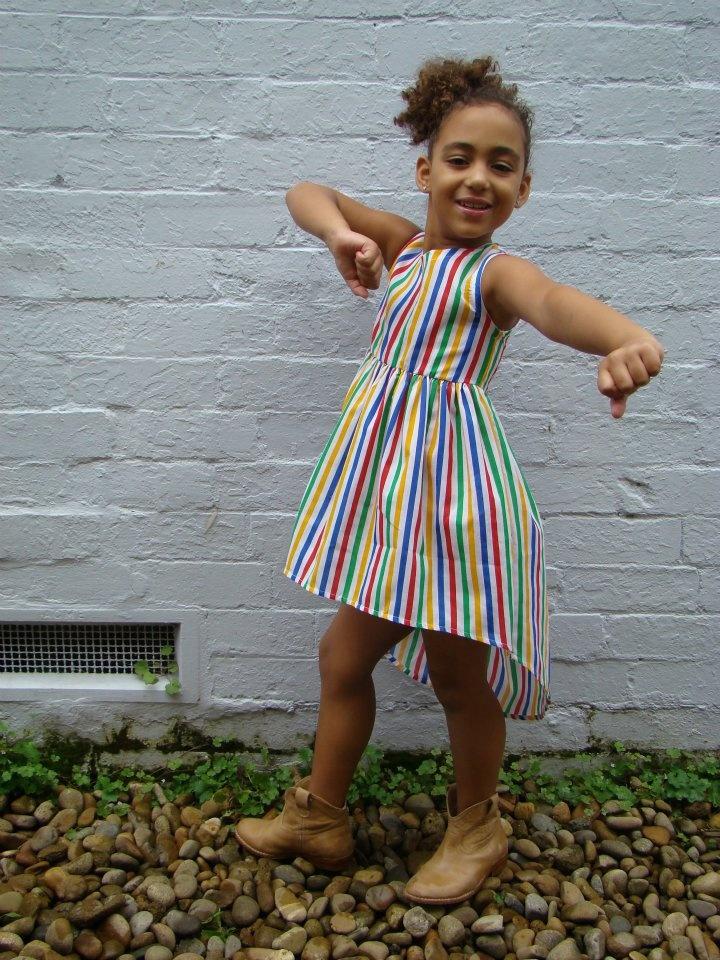 Tik e ta kids: Cassie dress. Scoop neck dress with long back. Multi stripe print on white. Sizes 2-8.