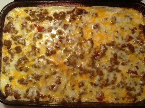 Creamy Burrito Casserole Brown Cook 1 lb hamburger or ground turkey & half an onion. Drain. Add a 16 oz can of refried beans & a pack of taco seasonings. Separately, mix can of mushroom soup & 4 oz sour cream & spread 1/2 of this in baking dish. Layer 3 torn up tortillas, meat mixture, cheese & hot sauce (optional). Sprinkle w/ more cheese (need total of 2-3 cups). Bake, uncovered, at 350°F for 20-30 min.