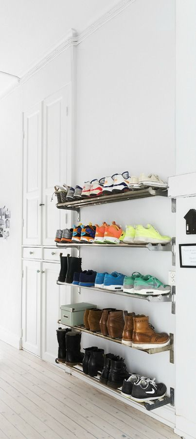 Don't let shoes clutter the hallways in your home. Find a creative and unique way to store them! With over 40 ways to organize your shoes, you're sure to find the perfect solution. We love these shallow vertical shelves that take up minimal room to save you space.