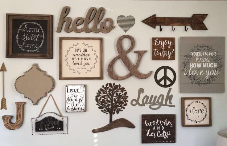 Rustic glam, chic, farmhouse, gallery wall, in our living room. Mostly neutral colors, wood and metal decor. You can find most of this decor at Hobby Lobby!
