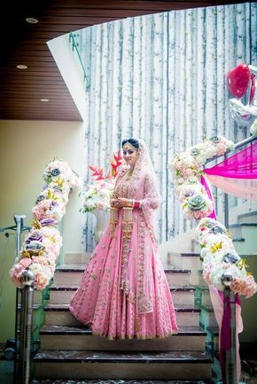 Morning bride in light pink and gold lehenga