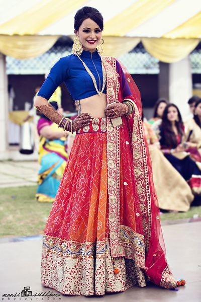 red and blue lehenga, contrasting lehenga and blouse, high neck blouse, collared blouse, mehendi outfit, mehendi lehenga