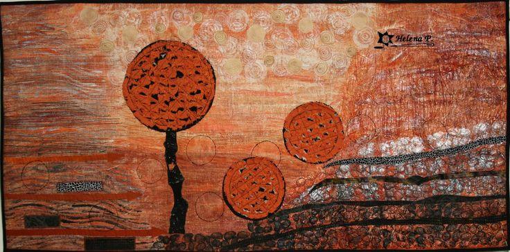 Patchwork obraz - Nerovná cesta Nástěnný látkový obraz na stěnu, zhotovený patchworkouvou metodou art quilting. Základ je bavlna a potom je povrch různě upravena a prošit. Je vypodšívkovaný a vyplněný pevnějším zažehlovacím vatelínem aby dobře držel tvar. Na zadní straně jsou poutka na provlečení tyčky. Rozměr šířka 101 x výška 50 cm.